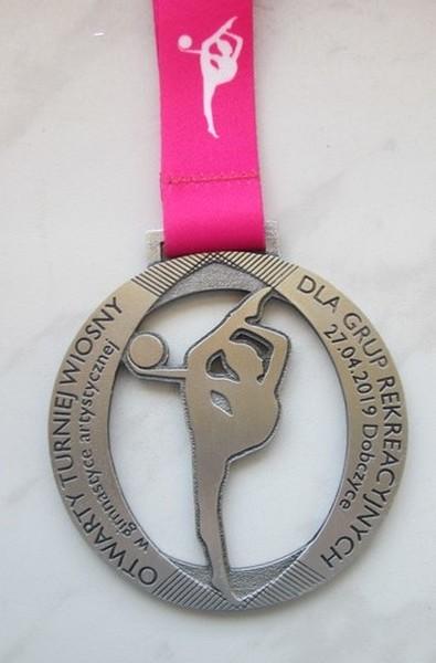 Medal odlewany na turniej gimnastyki artystycznej