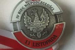 Medal odlewany, dodatkowo wzbogacony kolorowym nadrukem