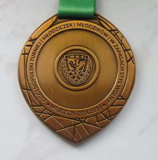 Bity medal na zamówienie, będący nagrodą w zapasach - wykonany przez ARTsKAM